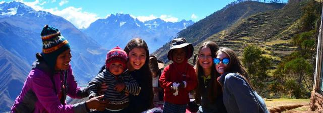 Teens play with local children on their community service program in Peru.