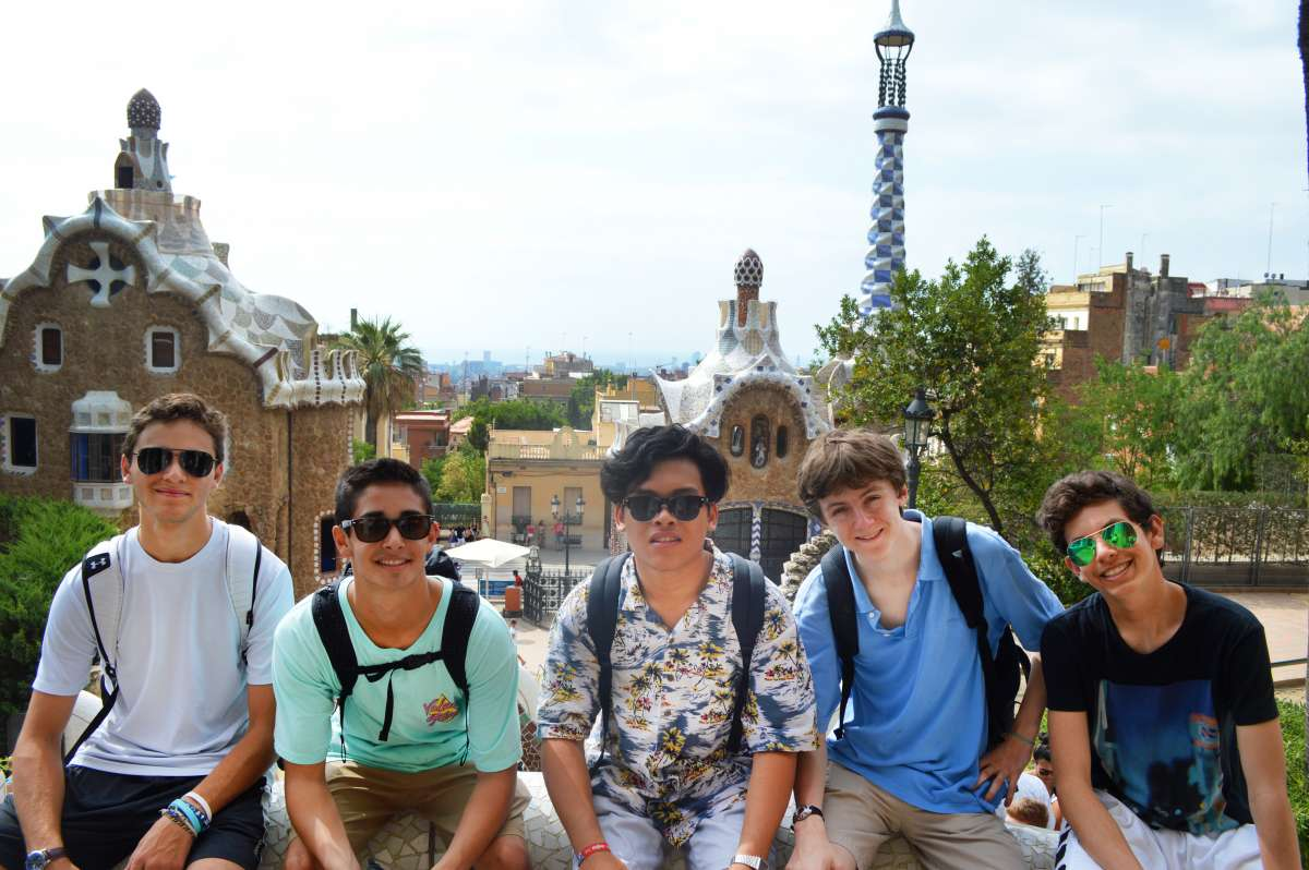 High school boys enjoying Parc Guell on summer trip in Barcelona Spain