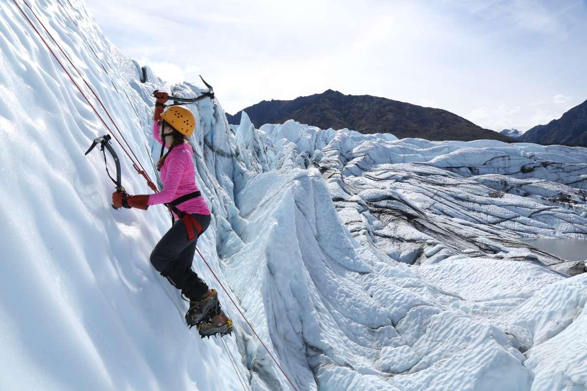 Teen girl ice climbs in Alaska on summer service program.