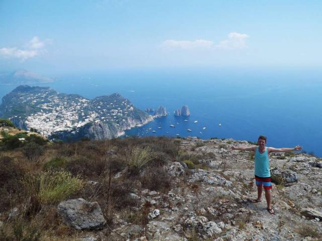 Teen traveler admires view from Capri Italy during summer youth tour