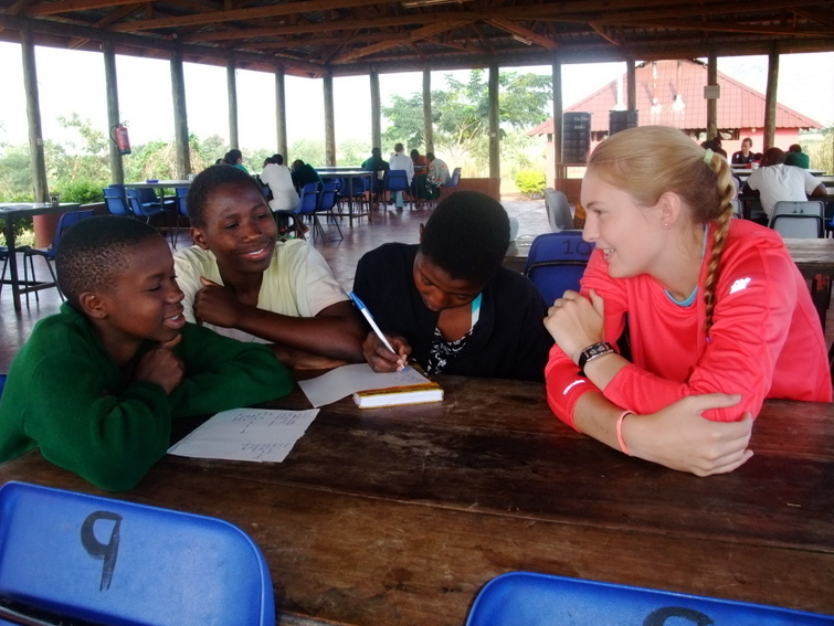 Teens spend time with local students on summer service and adventure program in Tanzania.