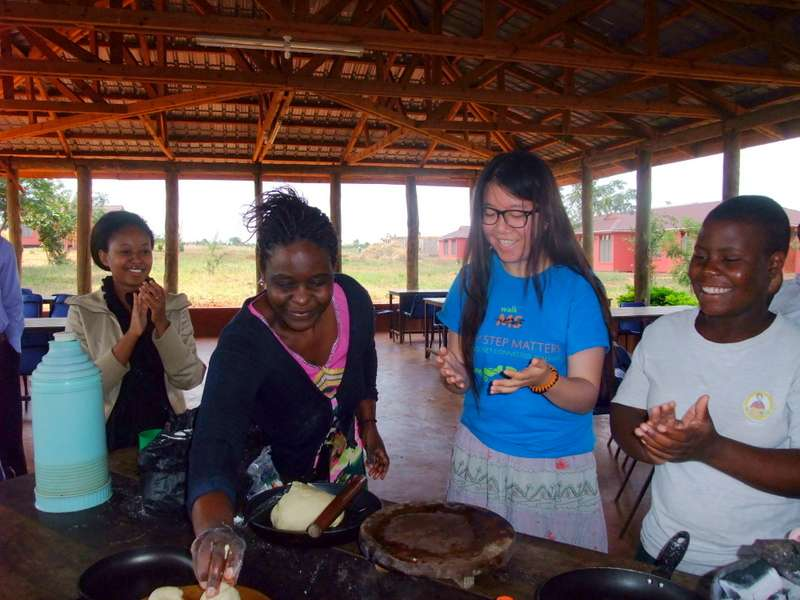 Teens learn how to cook during summer service and travel program in Tanzania.