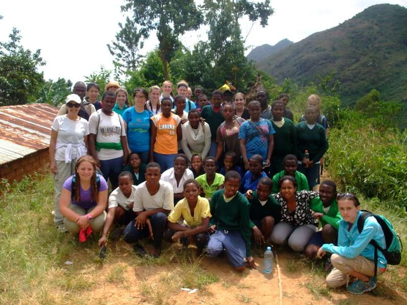Teens finish a hike with community hosts during summer service program in Tanzania.
