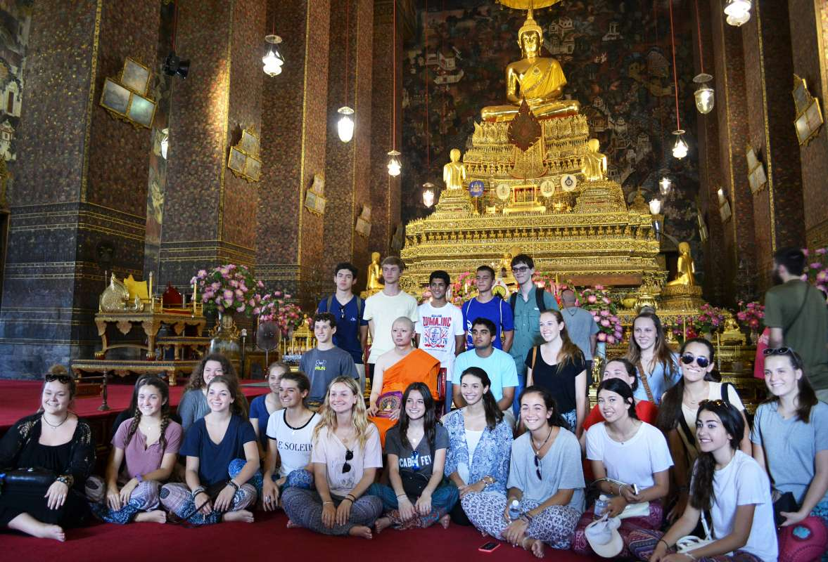 Teenage travelers participate in local ceremony during summer youth travel program in Thailand