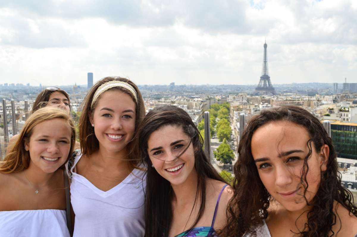 Teen girls enjoying views of Eiffel Tower during summer travel program