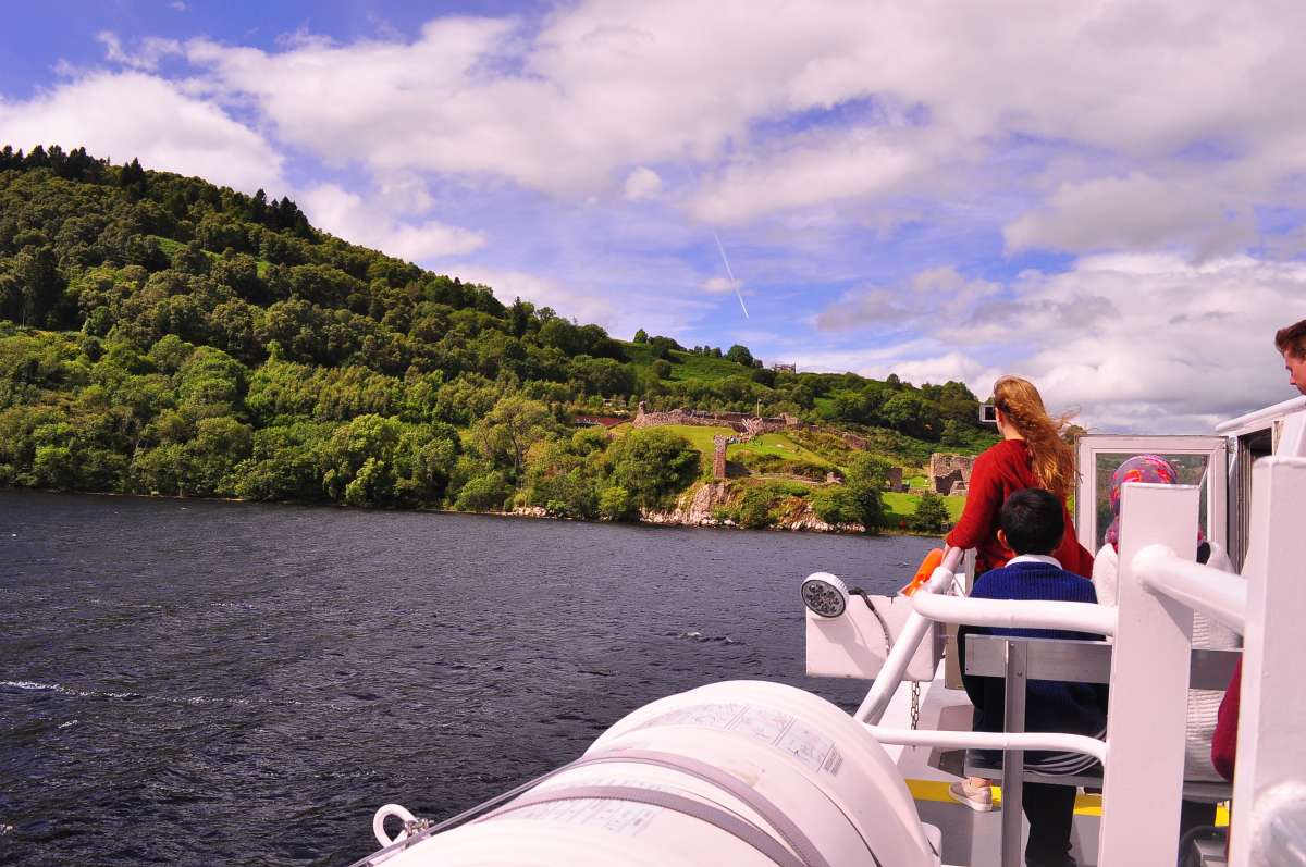 Teenage travelers on Loch Ness boat cruise during summer youth travel program