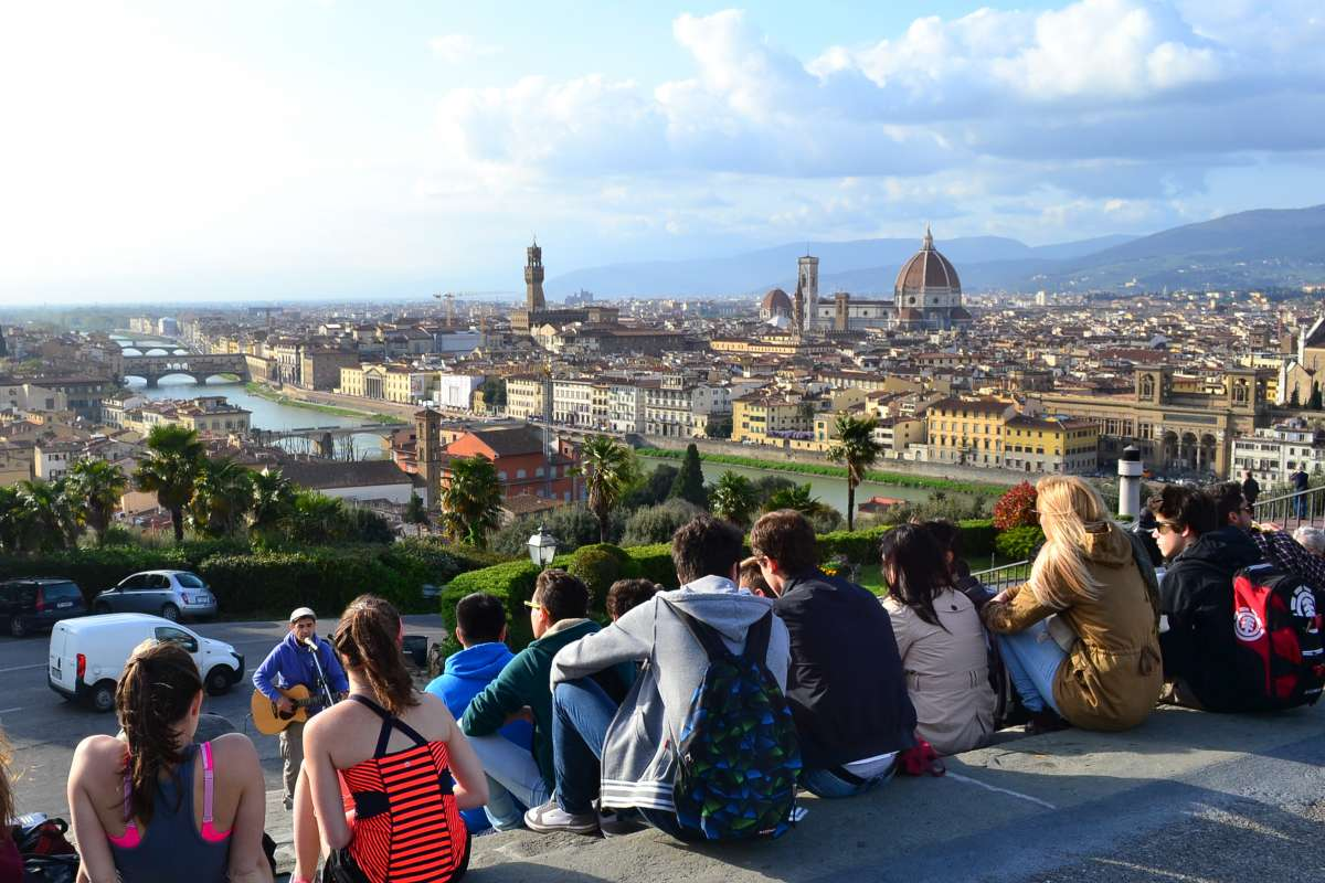 Teen travelers watch sunset in Florence on summer travel program