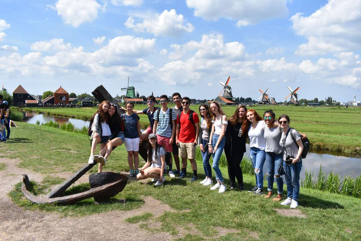 Teen travelers visit windmills in Netherlands on summer travel program