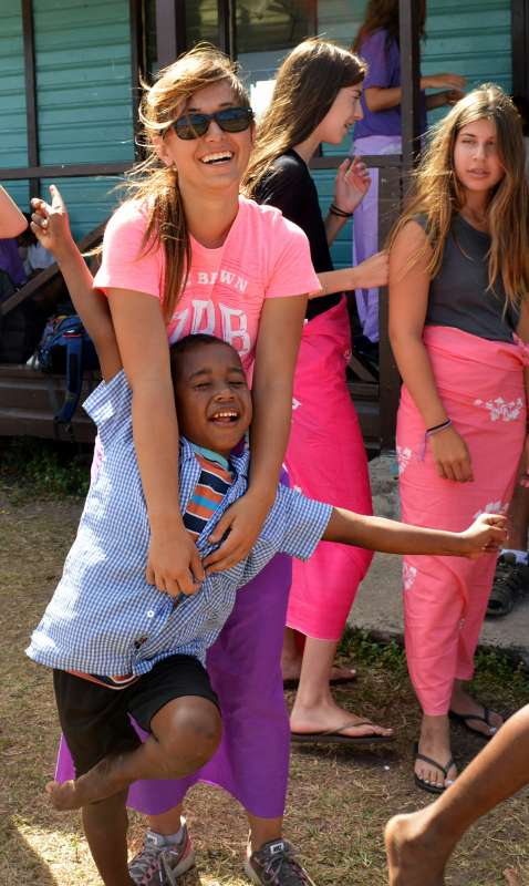 American teenager with Fijian boy during summer youth program in Fiji