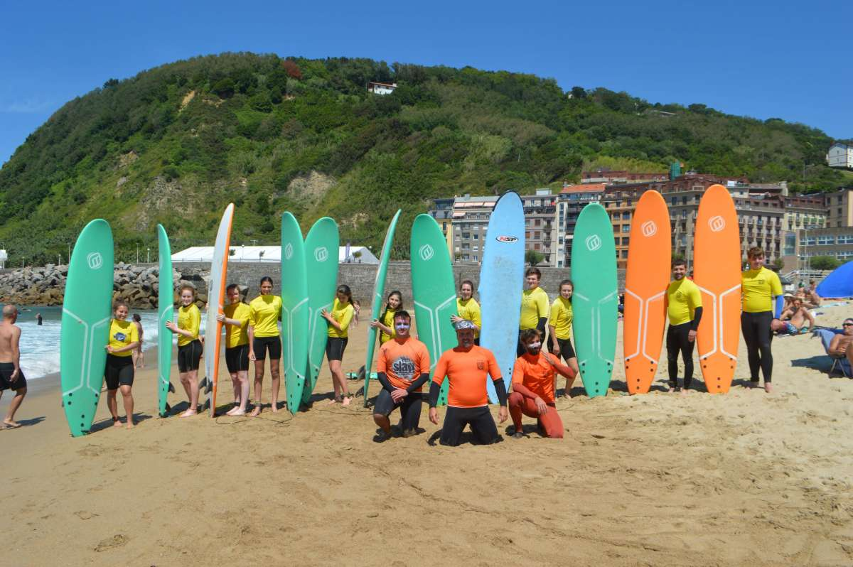 Teenage travelers at surf class in San Sebastian during summer Spanish language immersion program