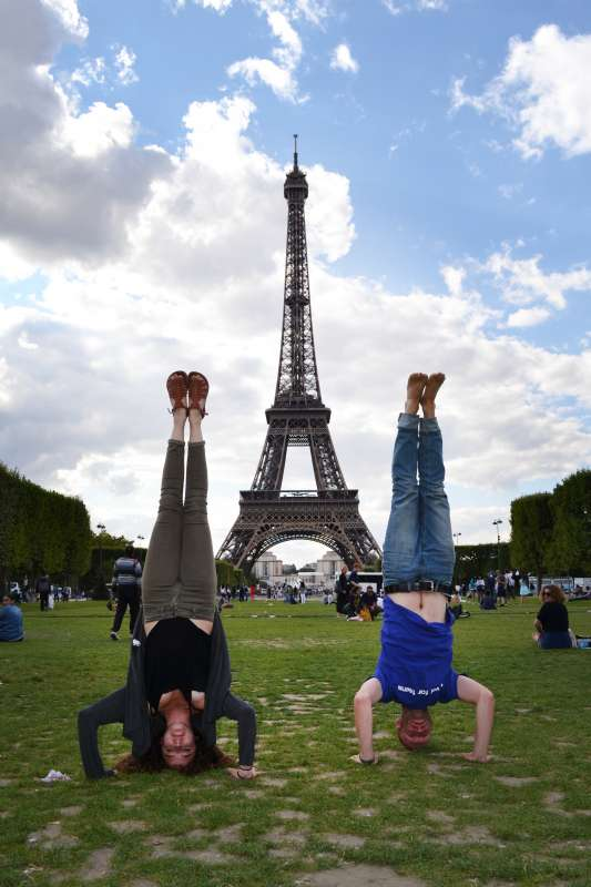Teens having fun at Eiffel Tower in Paris during summer youth travel program