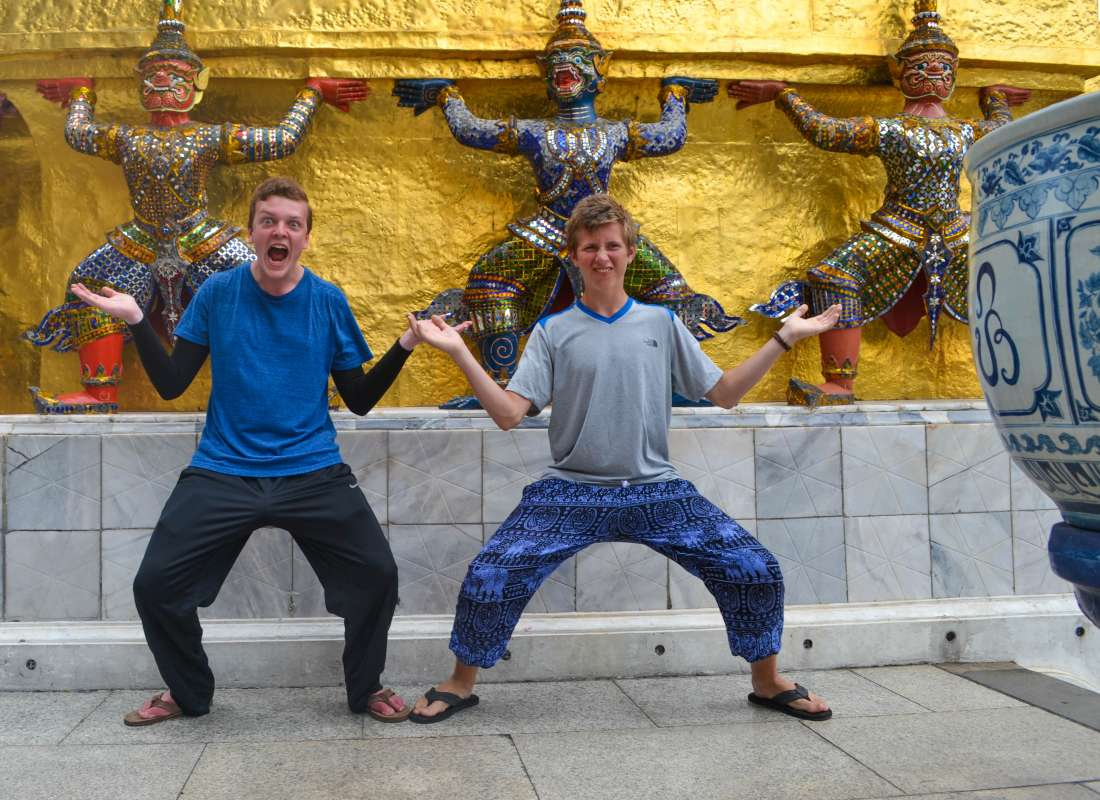 Teenage travelers having fun during summer youth travel program in Thailand