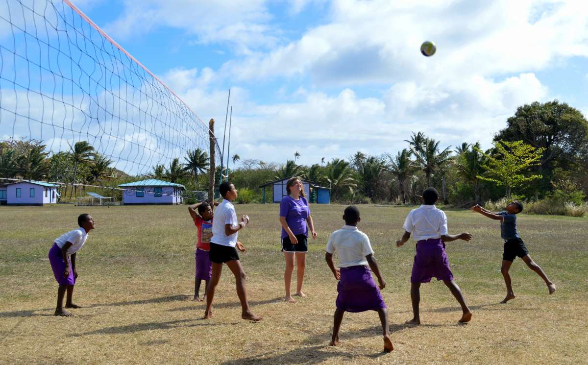 Fijian schoolchildren play volleyball during summer youth program in Fiji