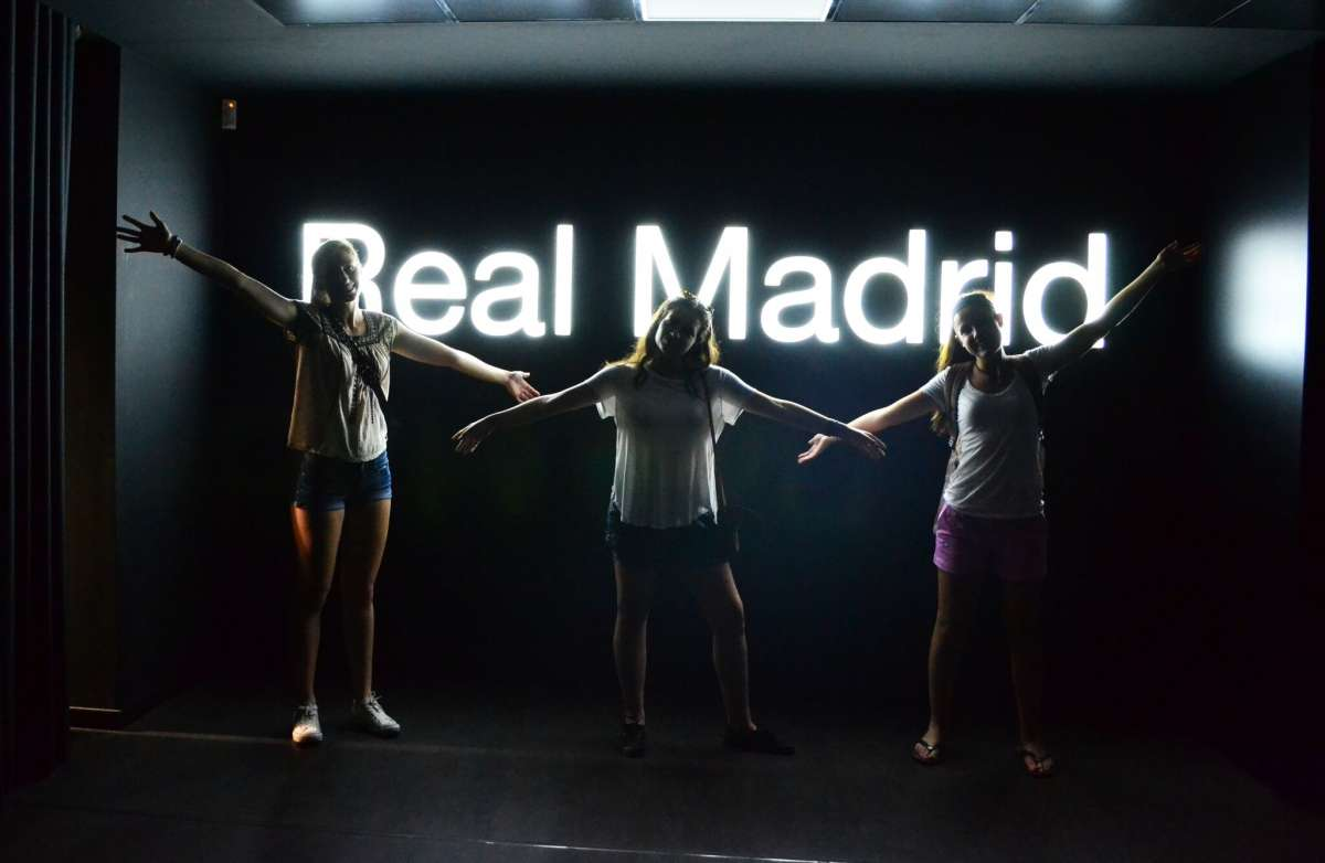 Teenage travelers at Santiago Bernabeu Football Stadium in Madrid during summer youth travel program
