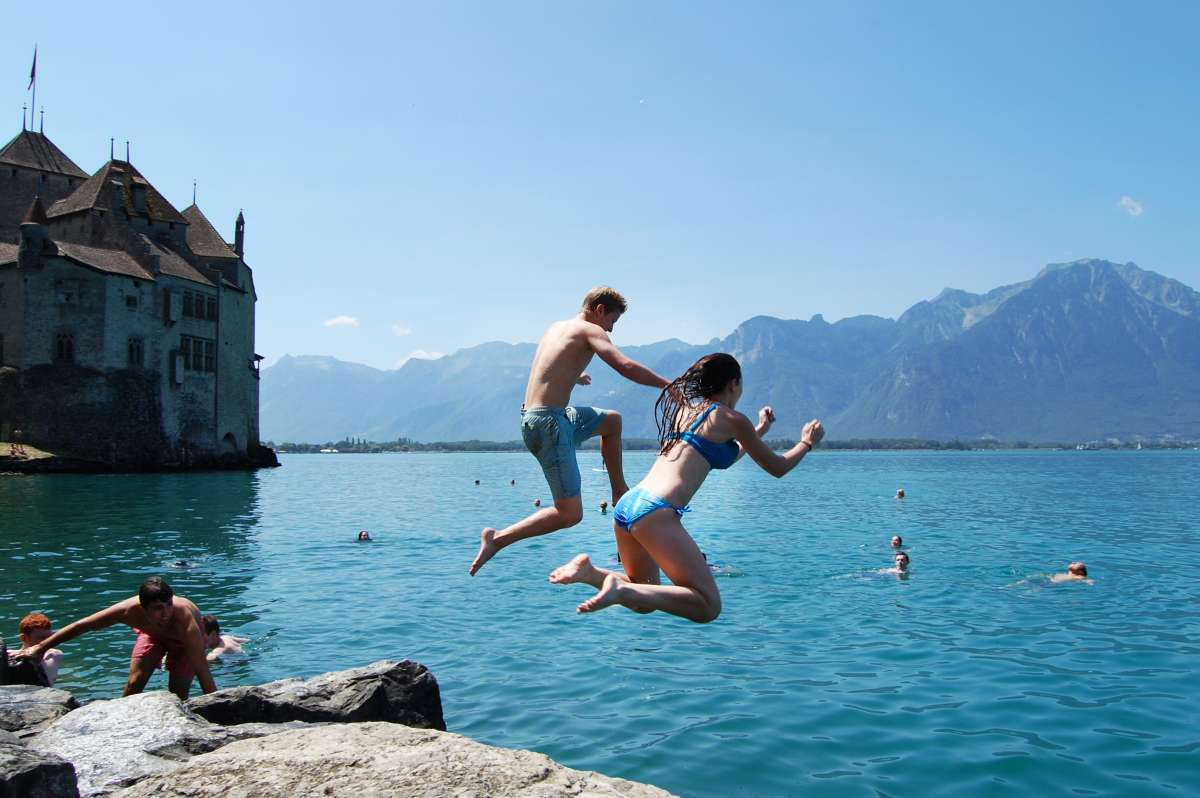 Teens jump into Swiss lake during summer travel adventure program