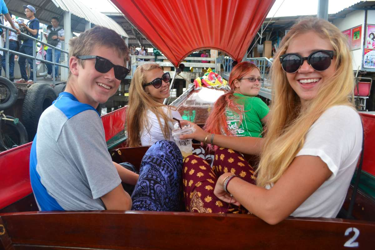Teenage travelers on rickshaw tour during summer youth travel program in Thailand