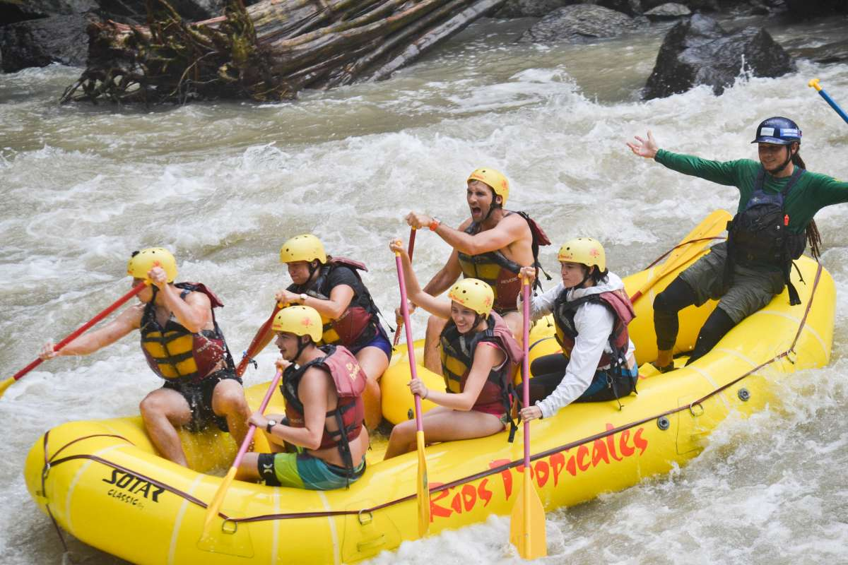 A group of teens rafts down a river on their summer adventure tour of Costa Rica.