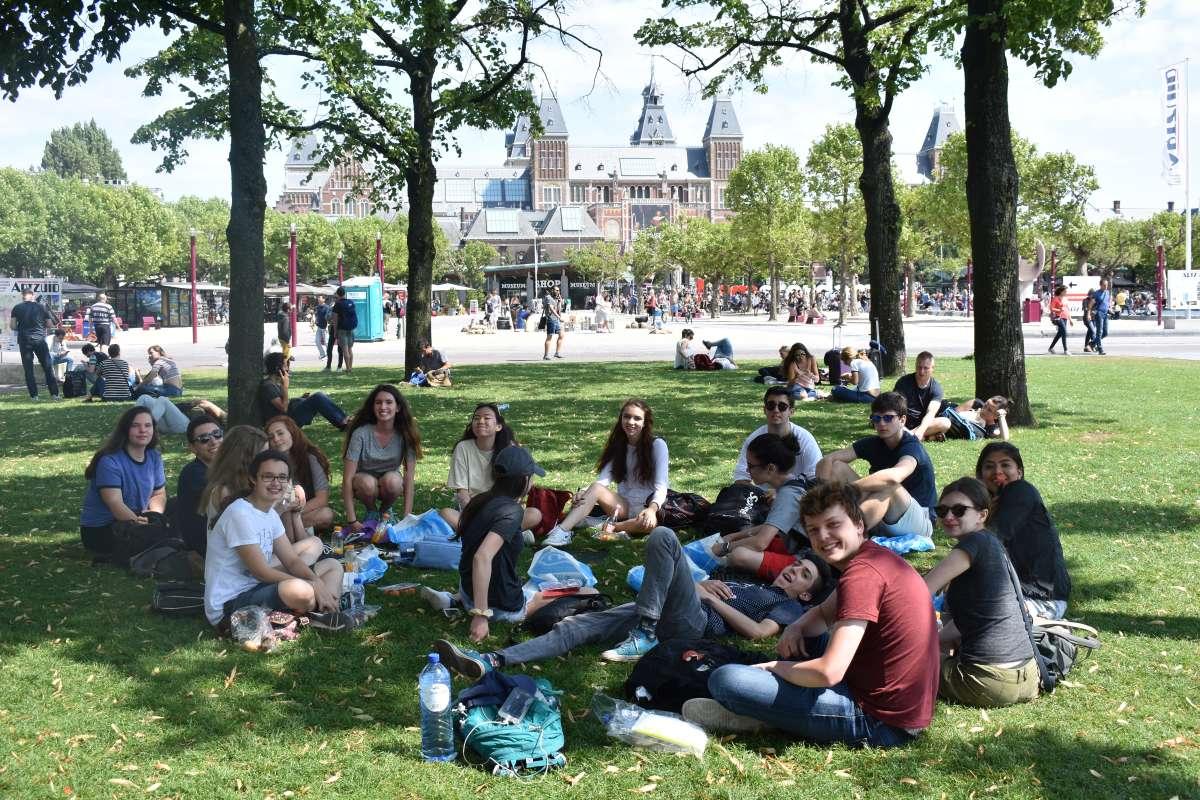 Teenage travelers in Amsterdam Vondelpark during summer travel program