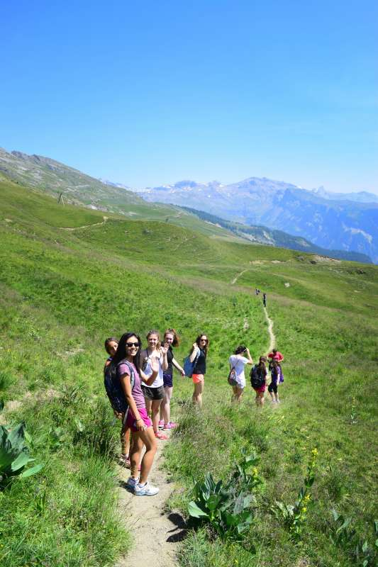 Teens hike through Swiss Alps on summer adventure travel program