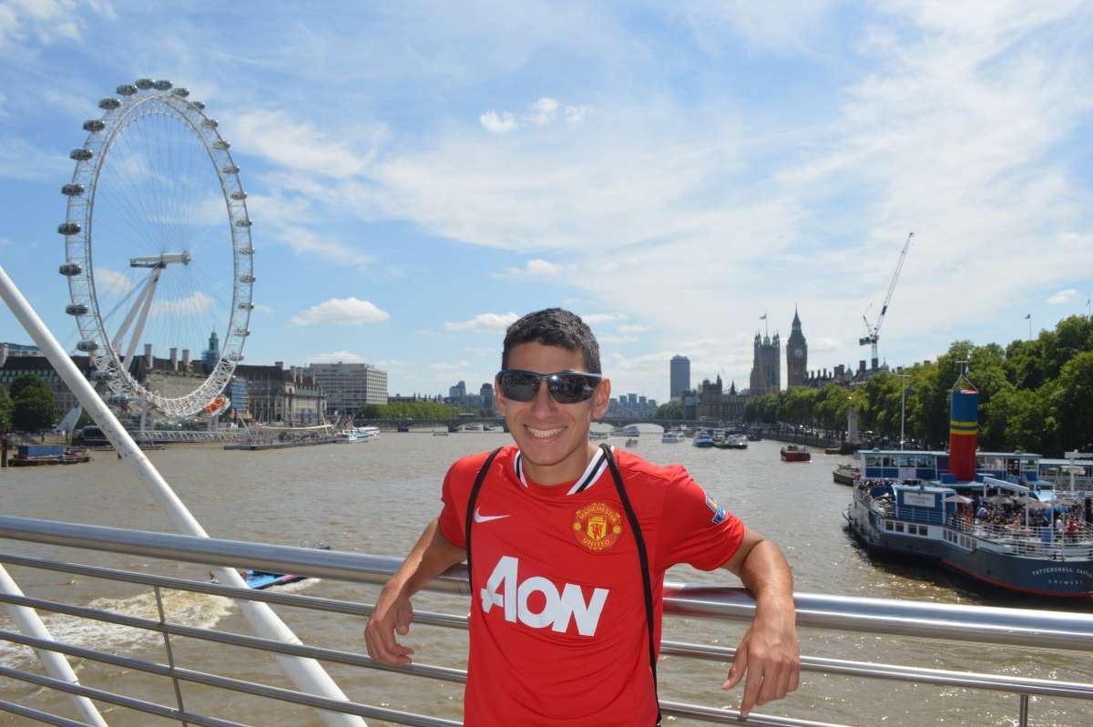 Teenage traveler with River Thames and London Eye during summer teen travel program in England