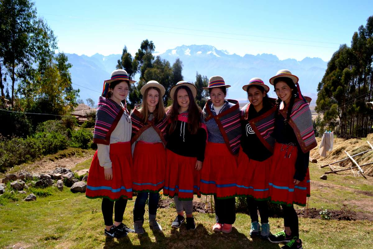 A group of students pose in traditional clothes on their summer teen tour of Peru.