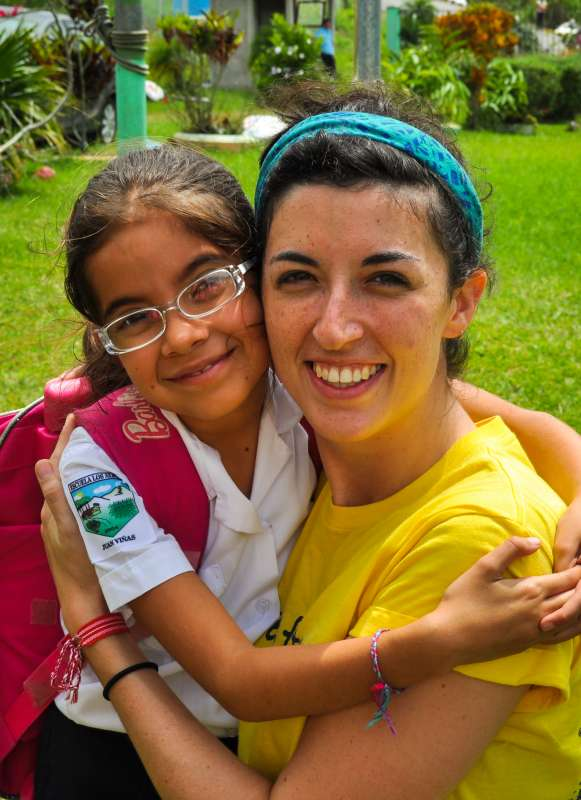 Students spend time with local children on summer service program in Costa Rica.
