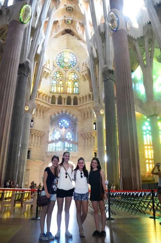 Teenage travelers in Sagrada Familia Barcelona during summer Spanish language immersion program
