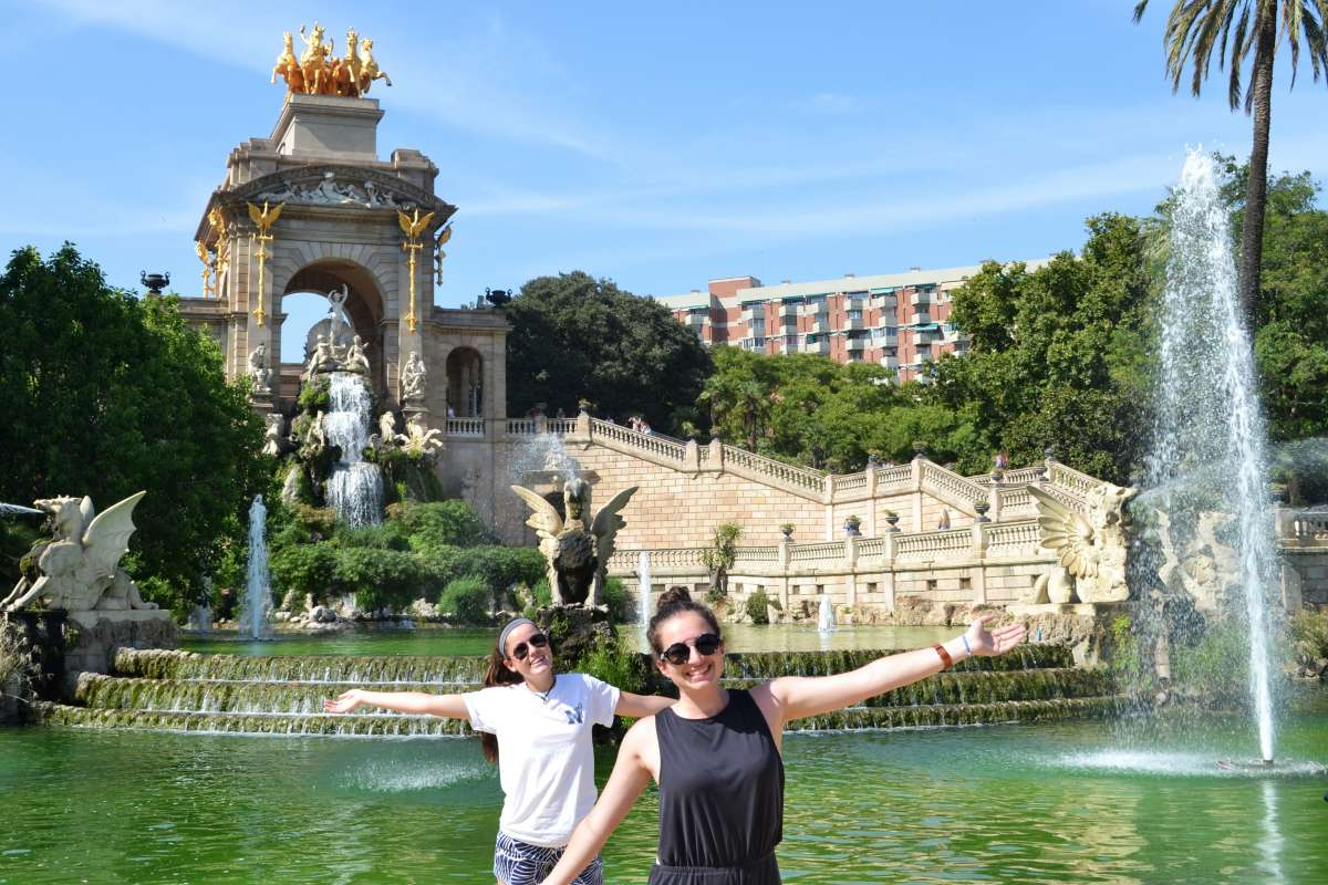 Teenage travelers in Barcelona park during summer Spanish language immersion program