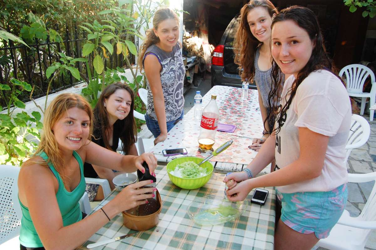 Teenage travelers try local delicacies during summer youth travel program in Greece
