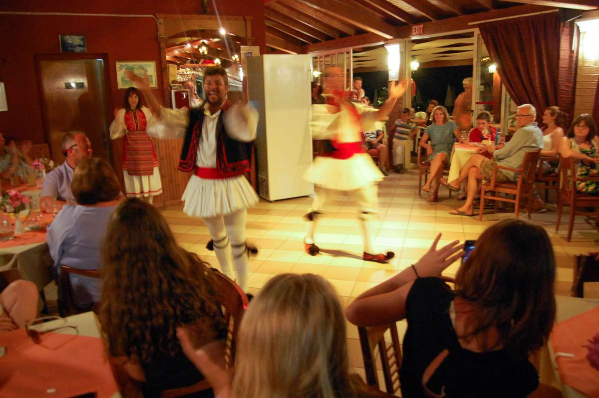 Traditional dancers perform for teenage travelers during summer youth travel program in Italy