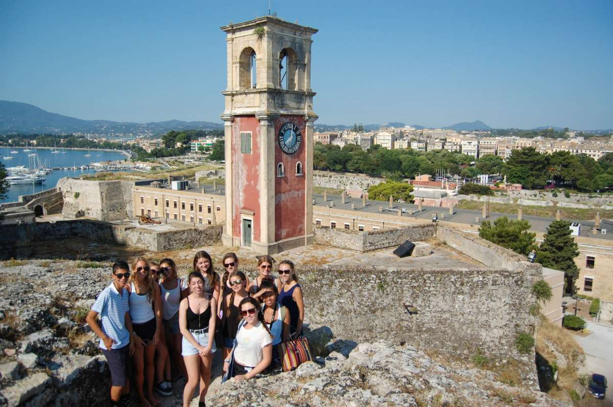 Teenage travelers visit archaeological site during summer youth travel program in Italy