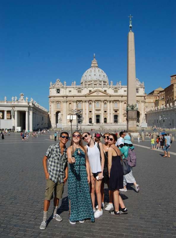 High school students pose in front of St. Peter's Basilica in Rome on their summer teen tour to Italy.