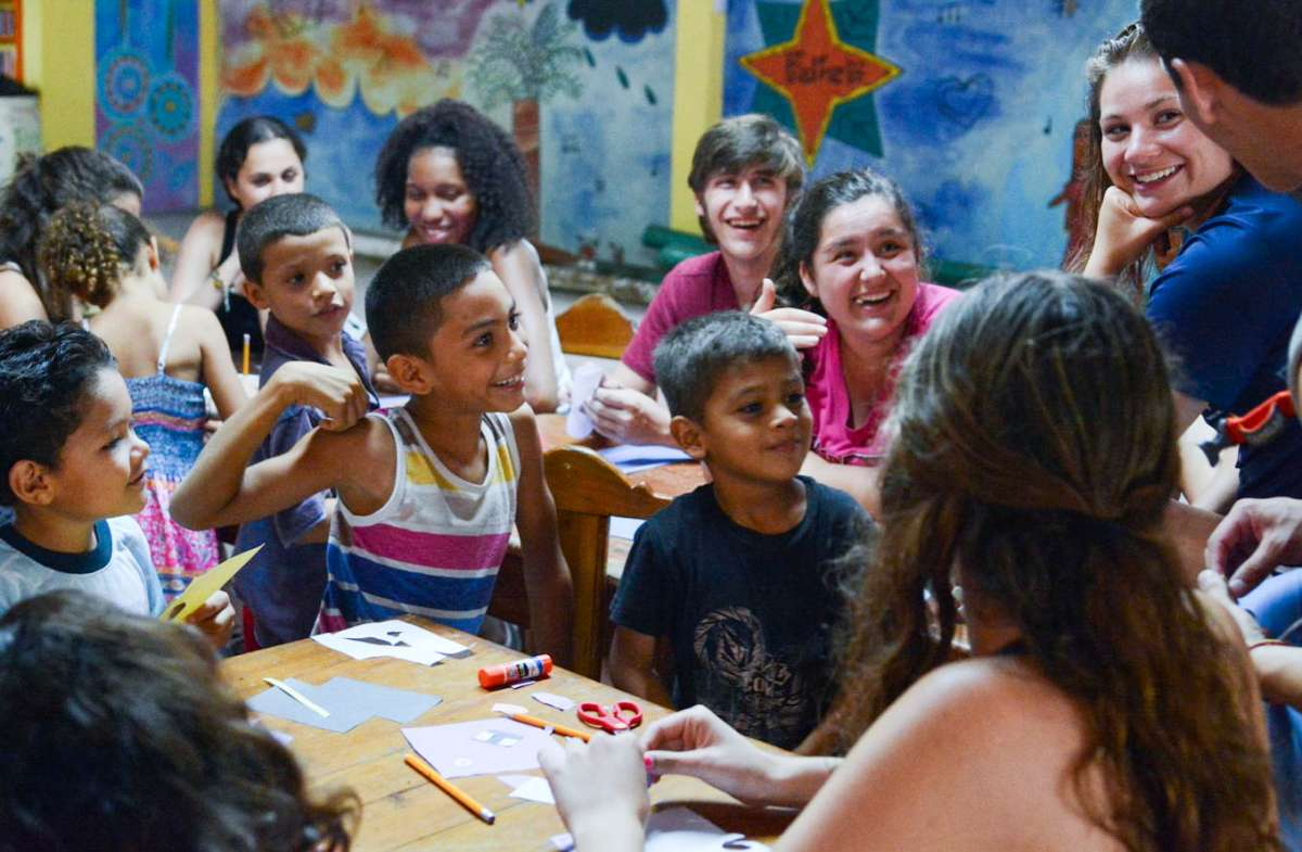 Students work with children as part of their community service teen tour of Costa Rica.