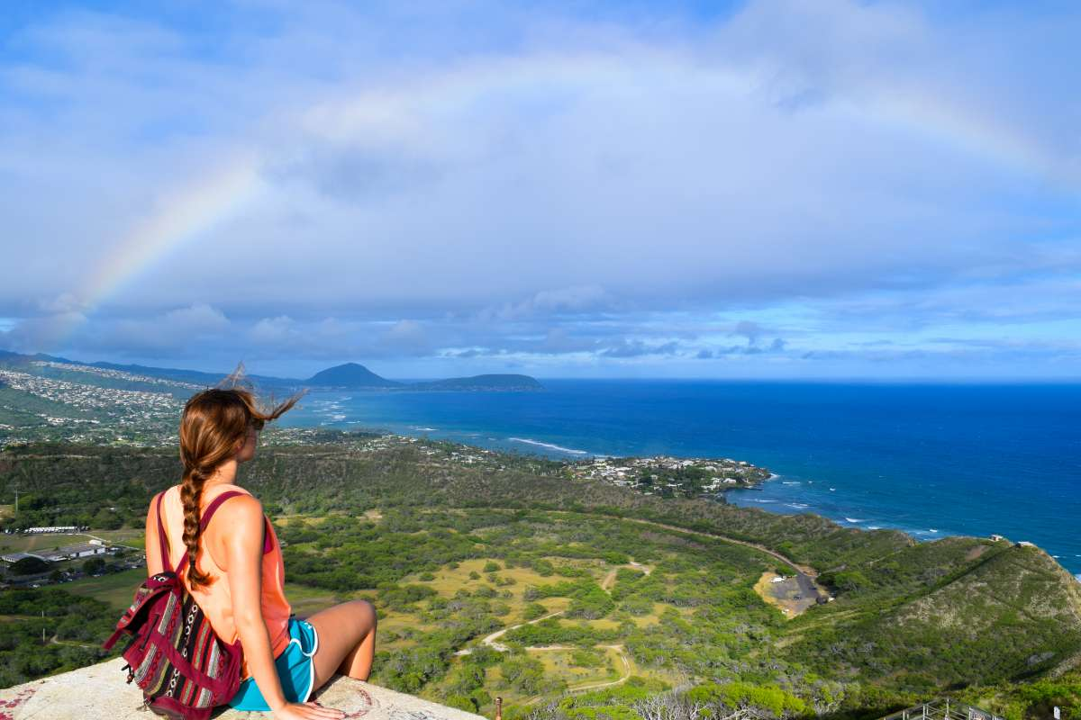 Teens admire a rainbow in Hawaii on summer service and adventure tour.