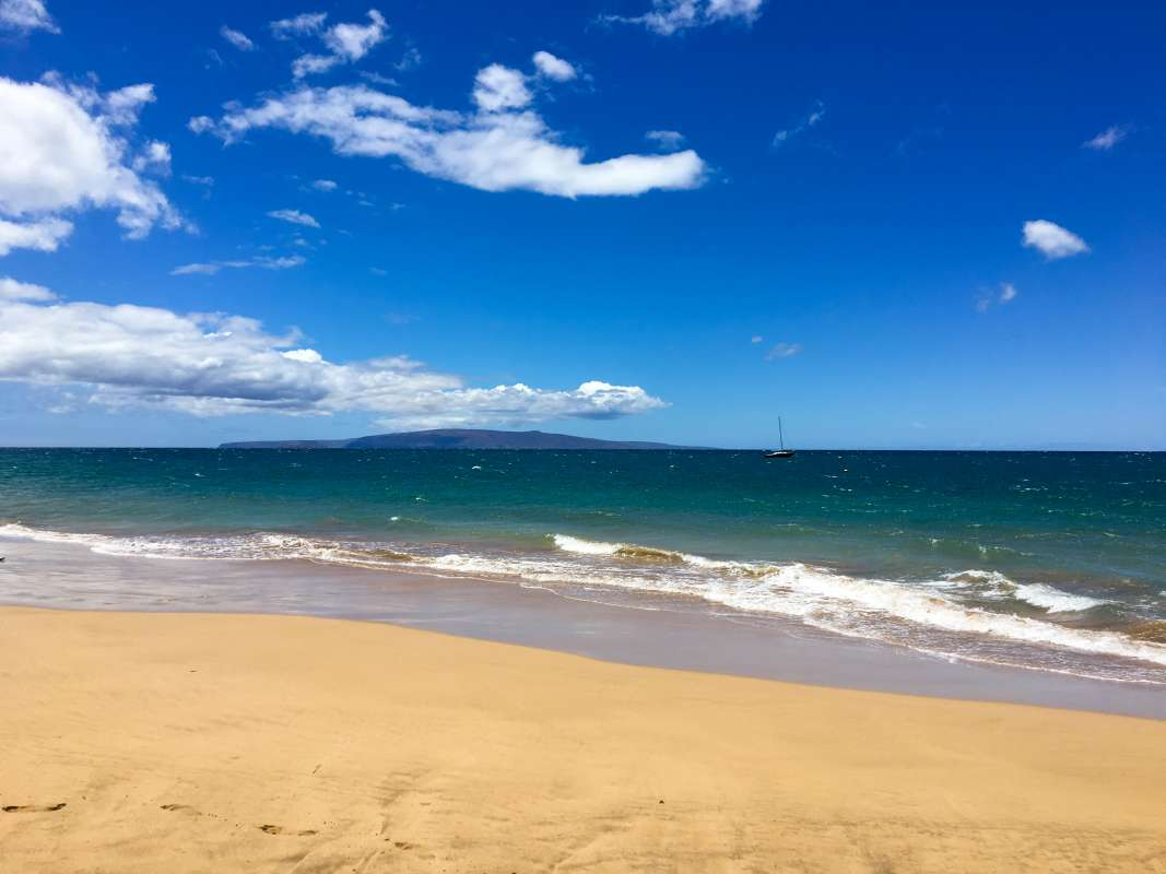 Students enjoy an empty beach in Hawaii on summer youth travel camp program.