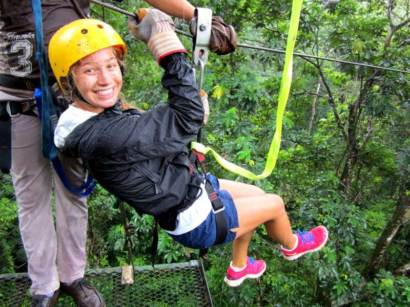 Teen goes zip-lining in Costa Rica on summer adventure program.