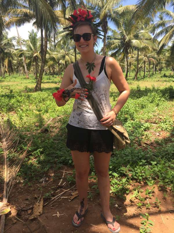 Teen wears flowers and henna in Zanzibar during summer service and travel tour of Tanzania.