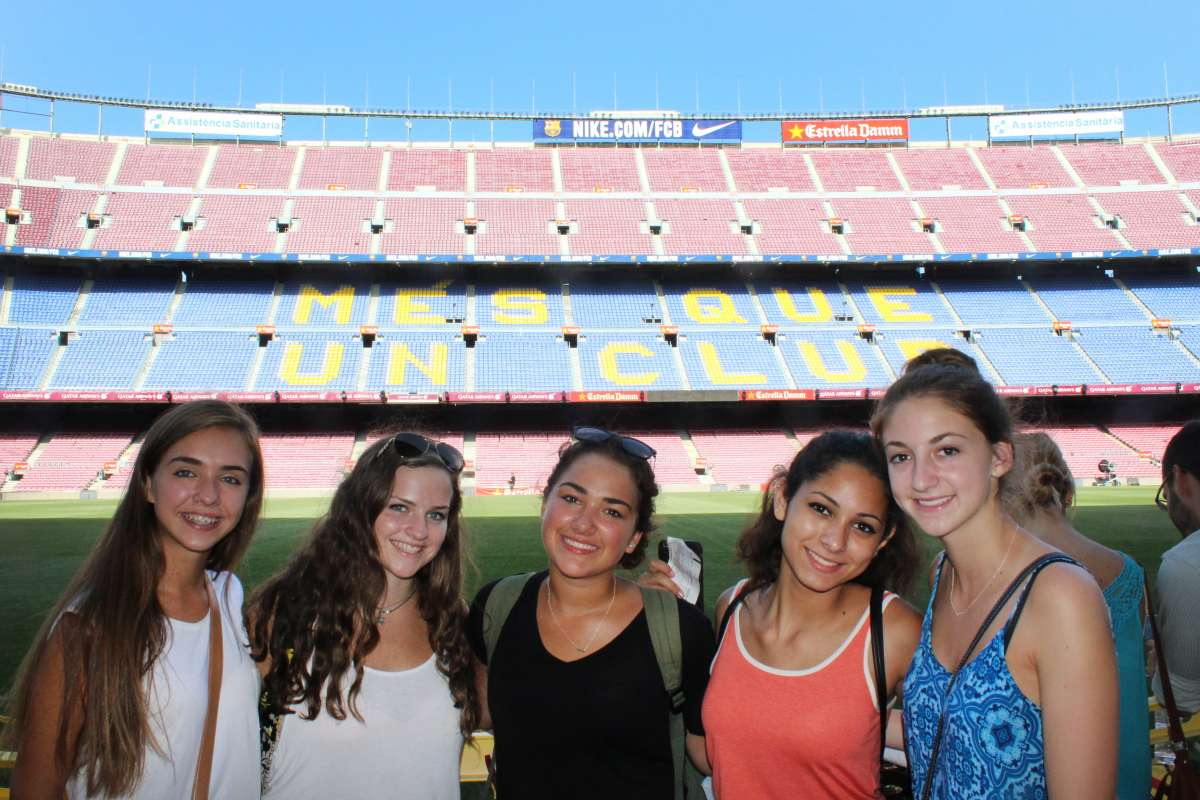 Teenage travelers visit Camp Nou football stadium Barcelona during summer Spanish language immersion program