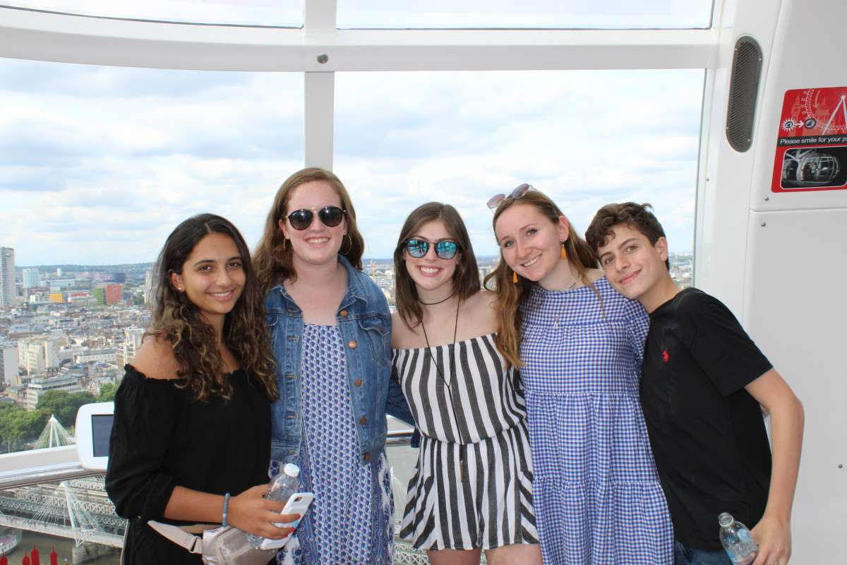 Teenage travelers on London Eye during summer travel program