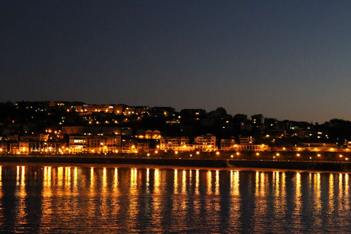 San Sebastian Spain skyline at night lights on water seen by teens during summer Spanish language immersion program
