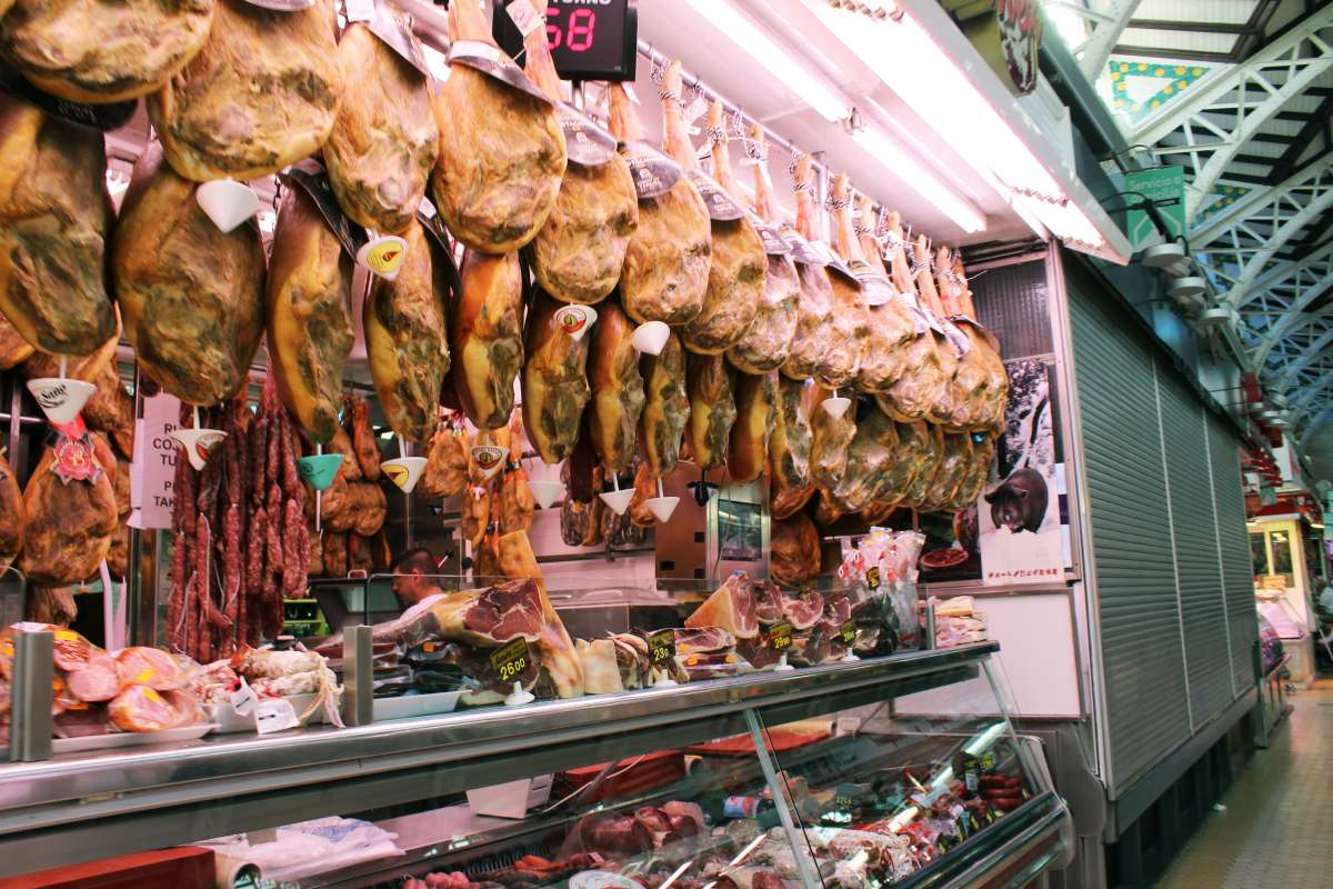 Jamon serrano seen in Spanish market by teens on summer Spanish language immersion program
