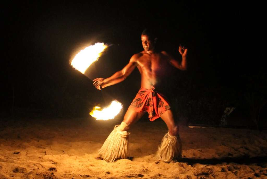 Man doing fire performance during summer youth program in Fiji