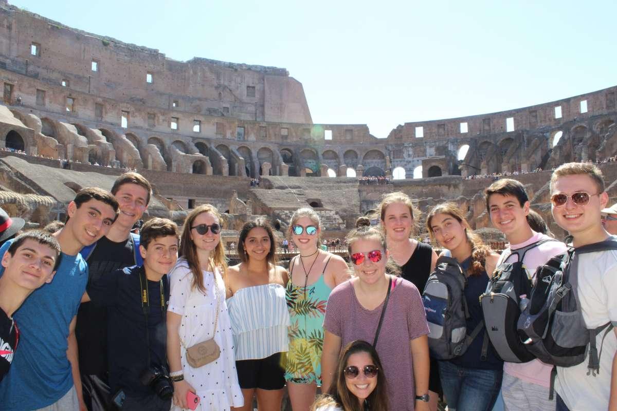 Teen travelers visit Colosseum during summer travel program in Rome