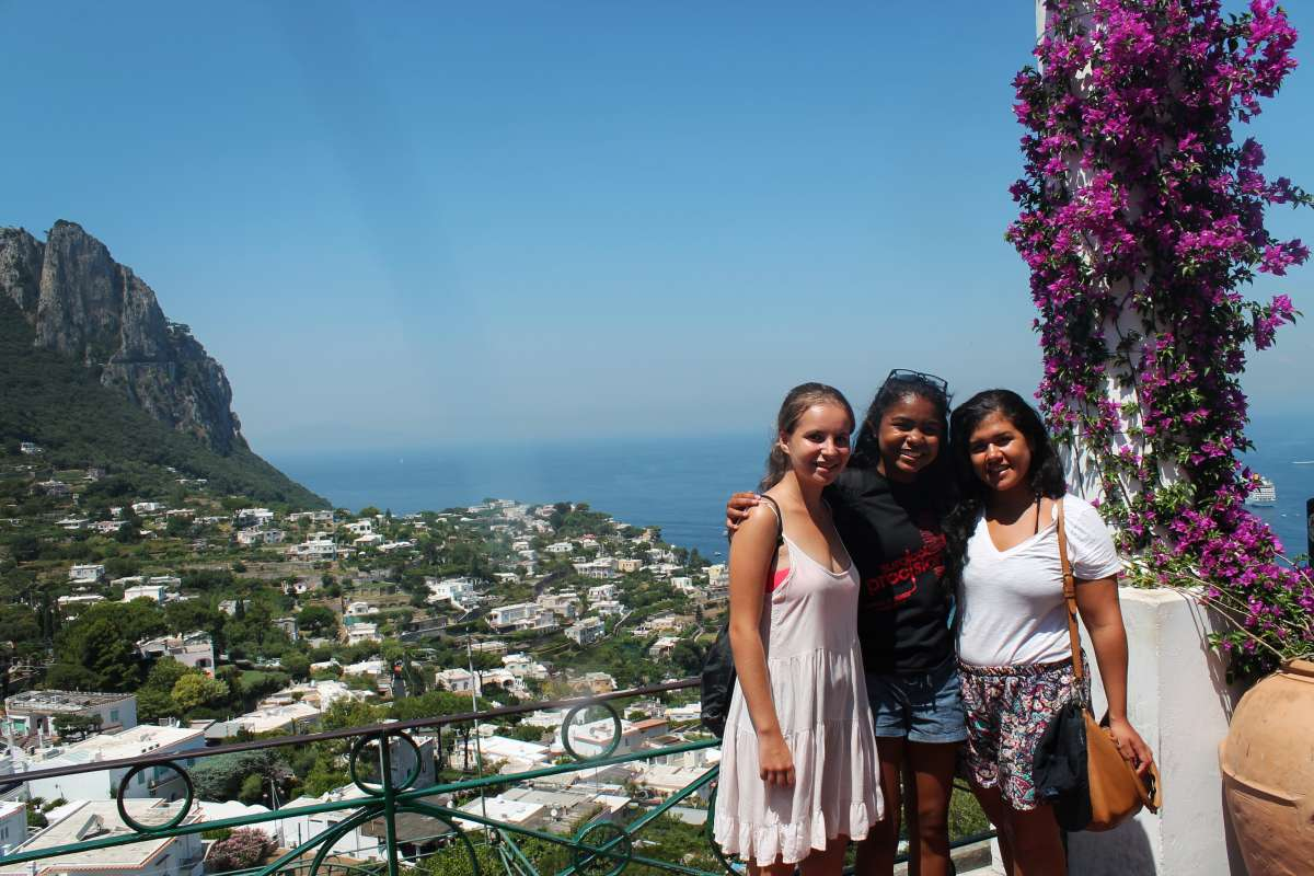 Happy teenage travelers on Capri during summer youth travel program
