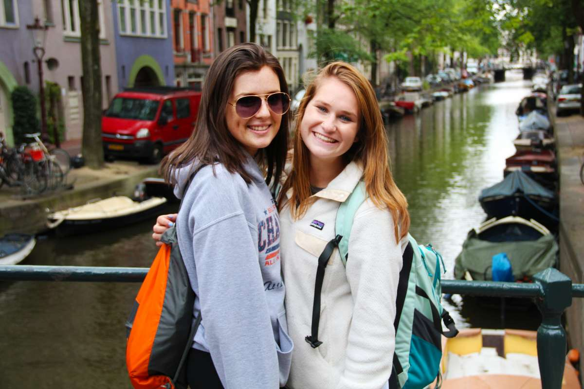 Teen travelers explore Amsterdam canals in Netherlands during summer teen travel program