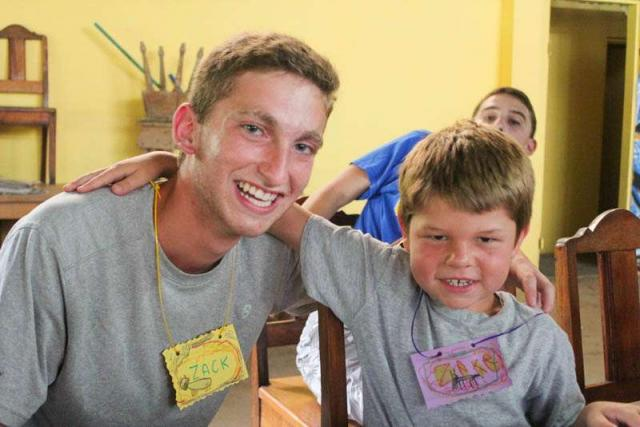 Teen boy makes a new friend during summer service program in Costa Rica.