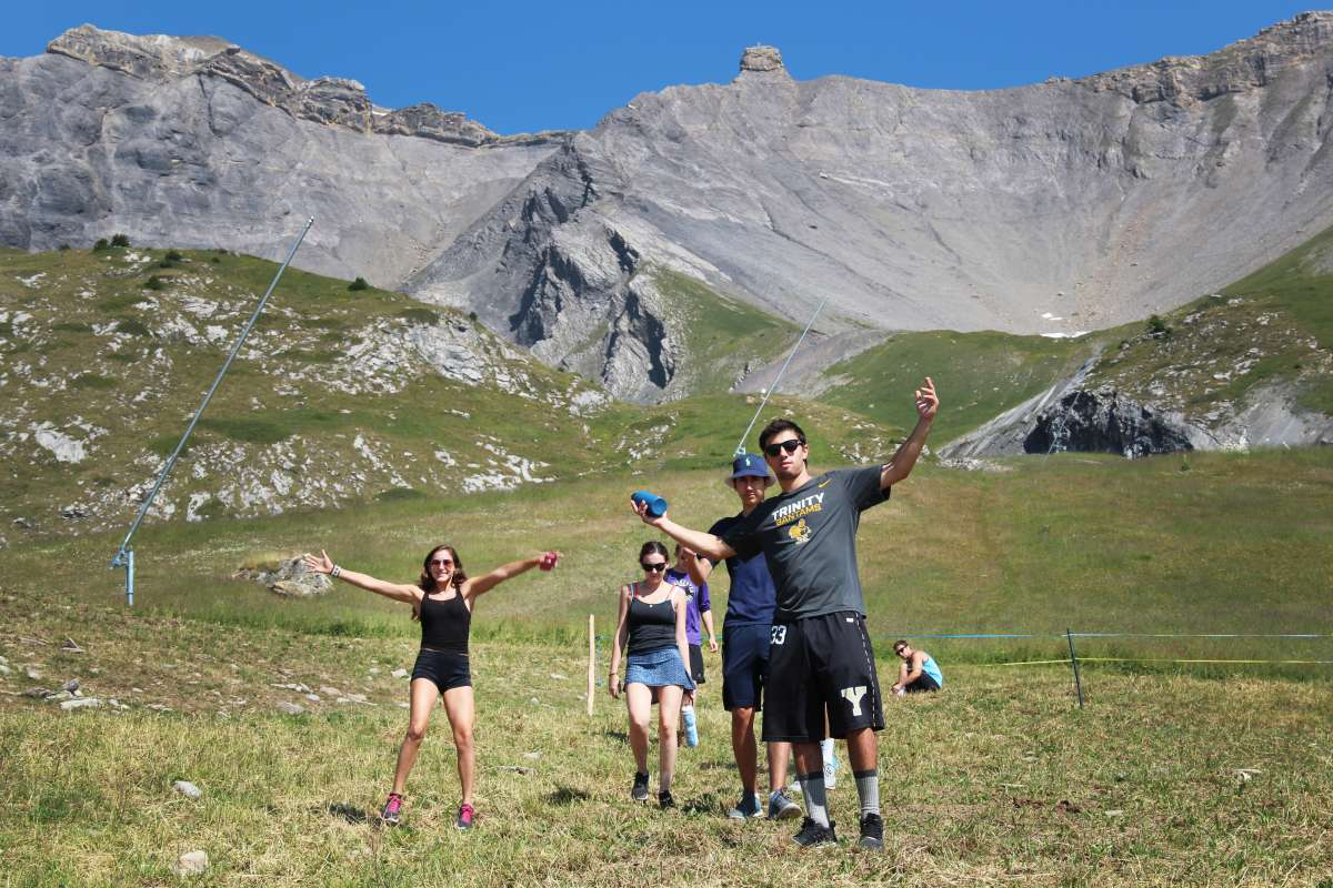 Teens hike in Swiss Alps on summer adventure travel program