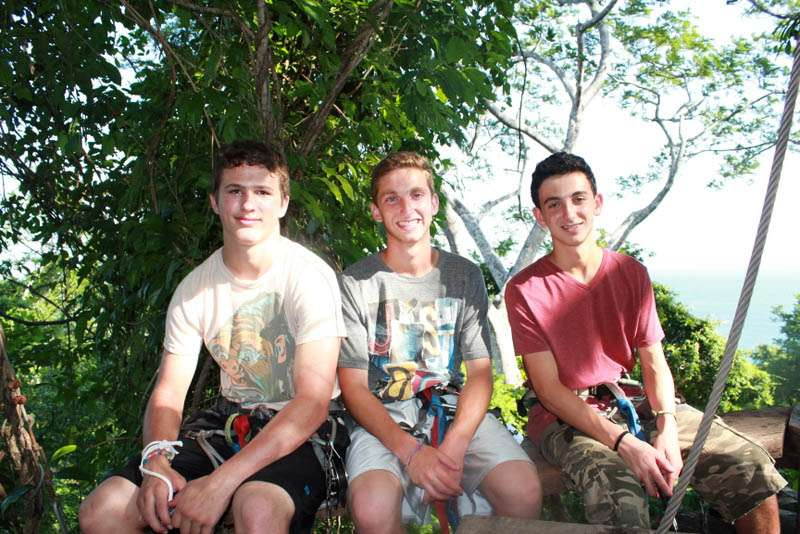 Teens pose for a photo in the nature of Costa Rica on summer travel program.