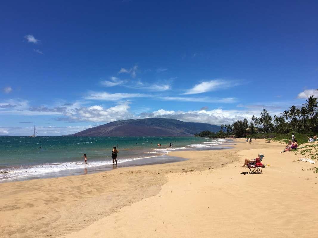 Teens enjoy the beach in Hawaii on their summer service program.