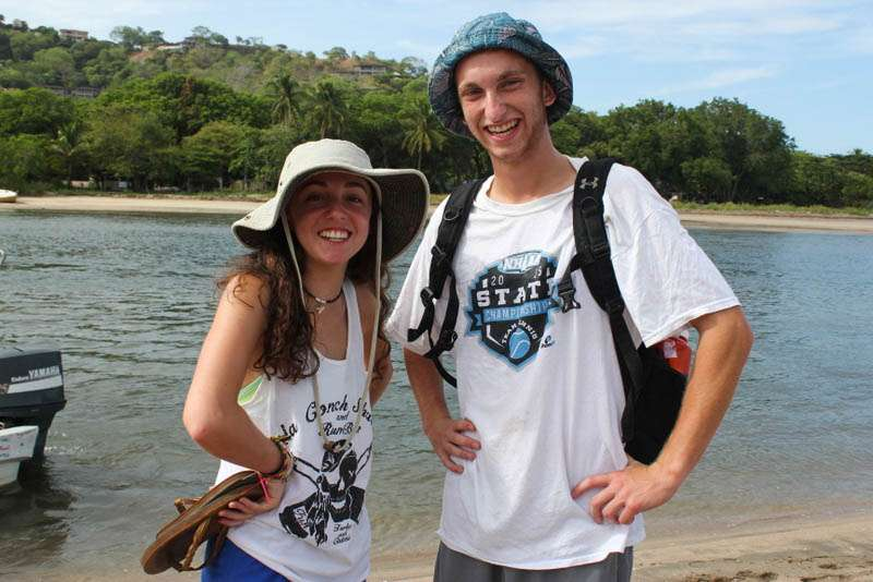 Teens take a funny hat photo on their summer travel program in Costa Rica.